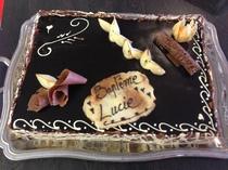 Un évenement à fêter ? Nous réalisons aussi votre dessert festif ! Voici le délice Lucullus (poire, mousse au chocolat, caramel au beurre salé